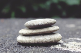 Canva - Selective Focus Photography of Cairn Stone